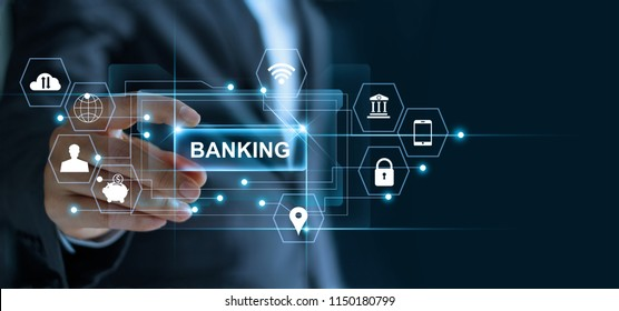 Businessman holding word banking in hand with icon network connection on virtual screen dark background
