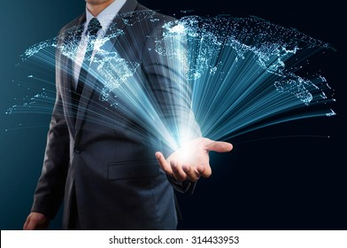 businessman holding world map made from glow line