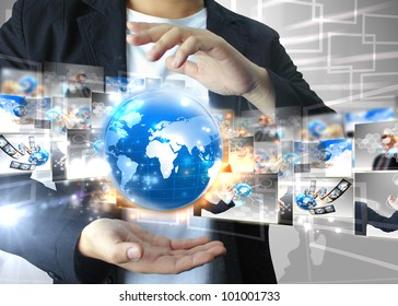 Businessman holding world .Technology concept