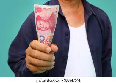 businessman holding yuan RMB in his hands,  worker wage money