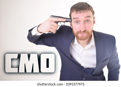The businessman holds a gun in his hand and shows the inscription:CMO