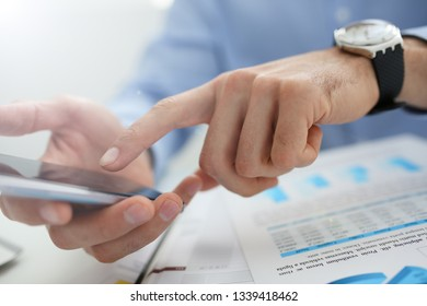 A businessman holds a new smartphone in his hand The mobile application market shows a display you can insert your image for advertising or financial statistics