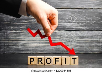 "A businessman holds a red arrow to down and the inscription ""profit"". Unsuccessful business and poverty. Profit decline. Loss of investment. Low wages. Economic crisis. The fall of the financial"