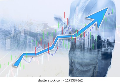 Businessman and Hong Kong city view with index chart (blue bull chart) on background. double exposure