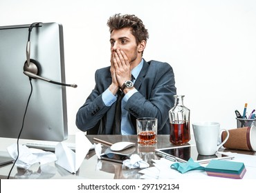 Businessman was horrified to look at the computer screen  / modern office man at working place, depression and crisis concept