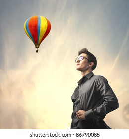 Businessman with hot-air balloon in the background