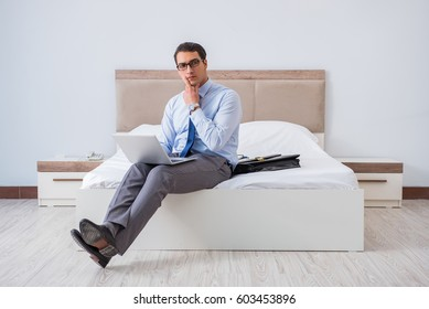 Businessman in the hotel room during travel