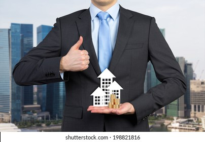 Businessman, house and coins