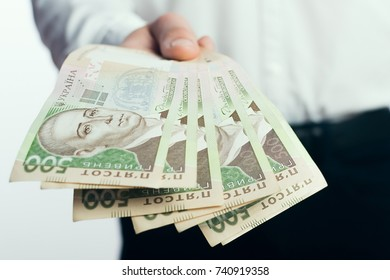 Businessman with hryvnia in his hands