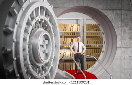 businessman and huge bank vault background