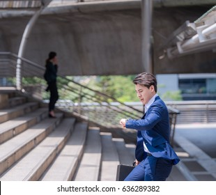 businessman in a hurry checking time and running, he is late for work his business appointment