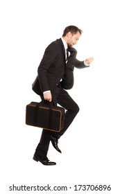 businessman in a hurry running on a white