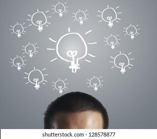 Businessman with an idea, drawn light bulb