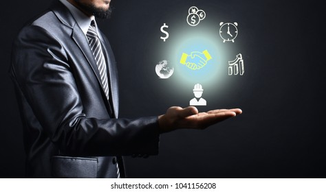 Businessman idea and icon on hand.