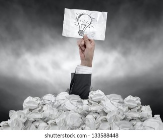 businessman with an idea under crumpled paper