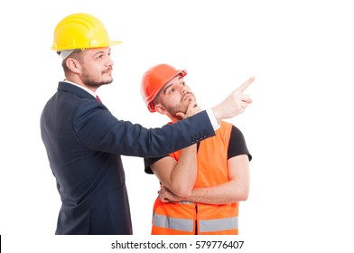 Businessman indicate or pointing something to builder or architect isolated on white background