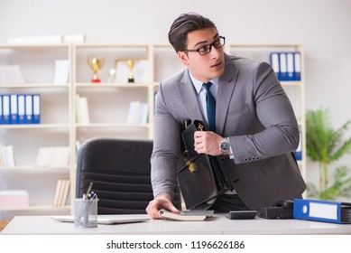 Businessman in industrial espionage concept