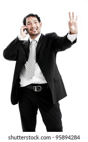 businessman inside, giving ok sign