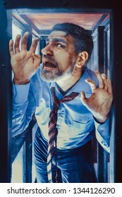 Businessman Inside of Glass Box. Concept of Captivity, No Freedom. Stressful Job, Pressure at Work. Lack of Space, Office Worker. Emotional Distress, Claustrophobia.