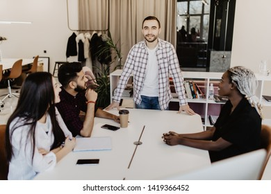 Businessman interacting with coworkers during meeting in office