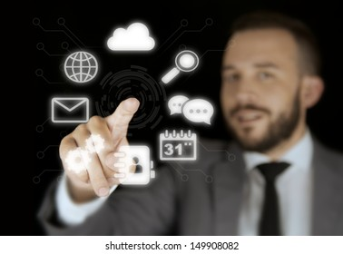 Businessman Interacting with a Virtual Interface on a Black Background