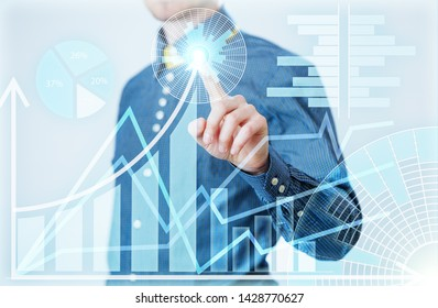 Businessman interacts with virtual screen, analyze data. Innovation Graphs Interfaces.