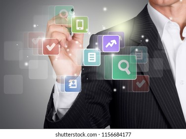 Businessman and internet virtual reality concept - businessman with pen on virtual screens