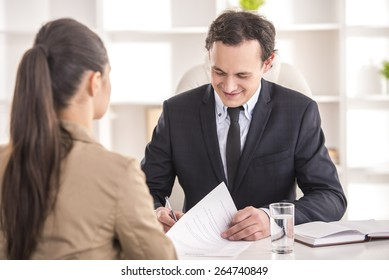 Businessman interviewing female candidate for job in office.