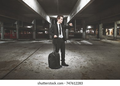 businessman into a desolated car park area