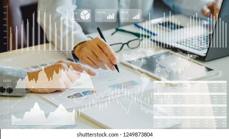 businessman investment consultant analyzing company financial report balance sheet statement working with digital graphs. Concept picture for stock market, cash, fund,and business economy flow.