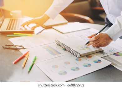 Businessman investment consultant analyzing company annual financial report balance statement working with documents graphics. Concept picture of economy,project, market, office,money and tax.