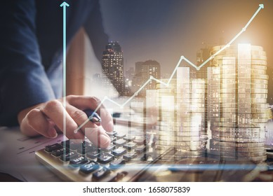 Businessman or investor using calculator to calculate growth income revenue  with step of coin and graph info, business successful financial from investment concept