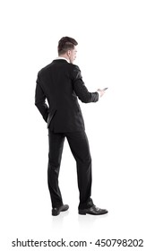 Businessman, isolated on white background, using mobile phone. Back view