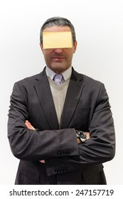 Businessman isolated on white with a post-it in his face as concept of editable message for business