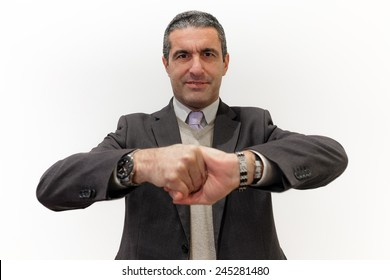 Businessman isolated on white that tightens his hands as concept of perseverance in business