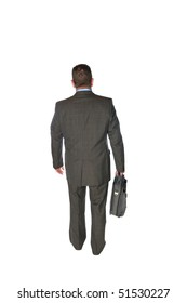 A businessman isolated on white walks away in a rear view fashion carrying his briefcase.