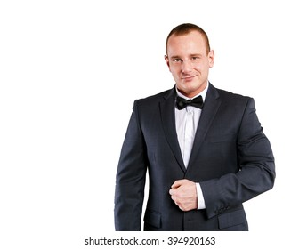 Businessman isolated over white background, smiling.