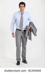 Businessman with jacket over arm