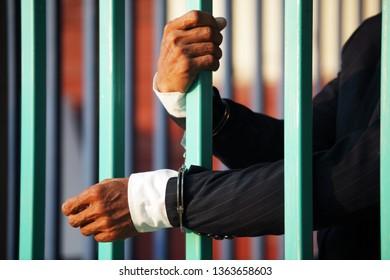 businessman in jail background.