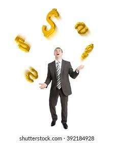 Businessman juggling dollar signs