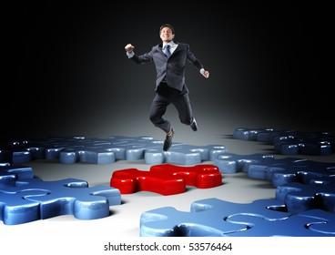 businessman jump over 3d jigsaw  puzzle
