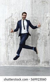 Businessman jumping in air, portrait