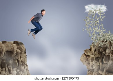Businessman jumping off the mountain looking rain of money on the other side, risky job pursue wealth concept