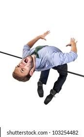 Businessman jumping over a high-jump bar