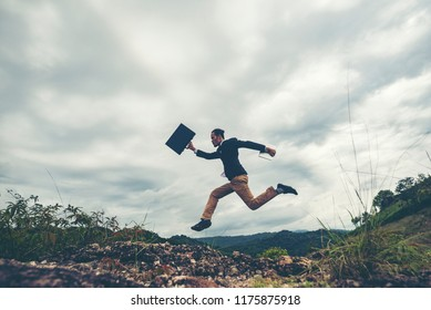 businessman jumping over the mountain, business worker concept