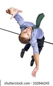 Businessman jumping over an Olympic high-jump bar