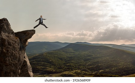 businessman jumps over the abyss, business concept