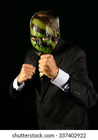 businessman with jungle camouflage paint