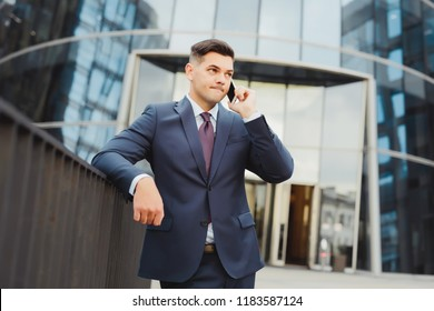 Businessman is justified before partners about bankruptcy. Young man in suit confused by information.