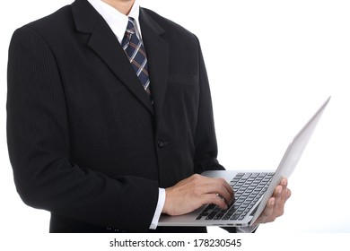 businessman key something with his laptop with white background